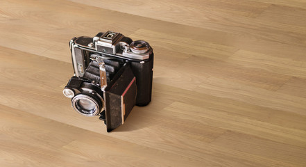 Parquet con macchina fotografica vintage
