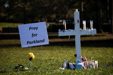 A cross commemorating the victims of the shooting at Marjory Stoneman Douglas High School is seen in a park in Parkland