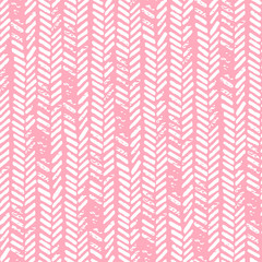 Cute seamless pattern. Pink and white colors. Grunge texture. Knitted ornament, braids, herringbone. Prints for textiles.