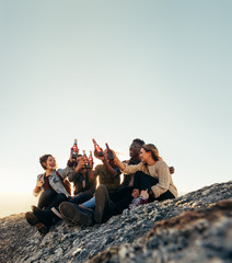 Friends on a mountain top partying with beers