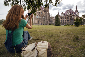 girl making a photo shoot of castle