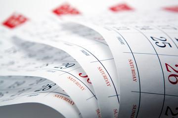 big pile of wall calendar sheets closeup