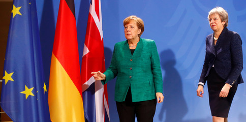 German Chancellor Merkel and Britain's Prime Minister May address a news conference after talks in Berlin