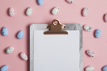 Easter background with easter eggs and a clipboard