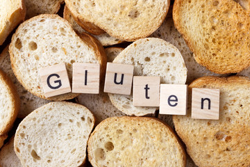 gluten text on Background from many small round rusks. Top view