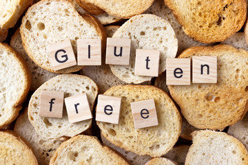 gluten free text on Background from many small round rusks. Top view