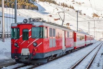 """""""Matterhorn Gottharn"""" railways train waiting in Dieni train station in Switzerland"""
