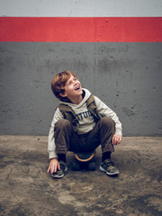 Cool little boy on skateboard