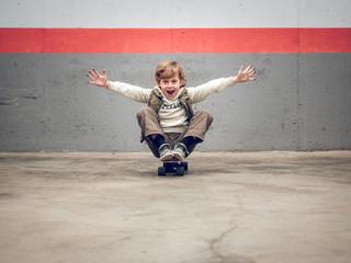 Cheerful boy on skateboard