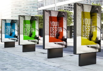 4 Advertising Kiosk Mockups on a City Street 1