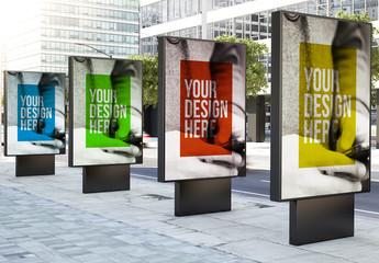 4 Advertising Kiosk Mockups on a City Street 1