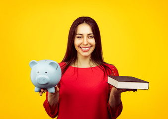 Cheerful woman with book and moneybox
