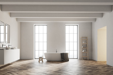Interior of a white bathroom with wood floor