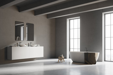 Corner of a gray bathroom with white floor