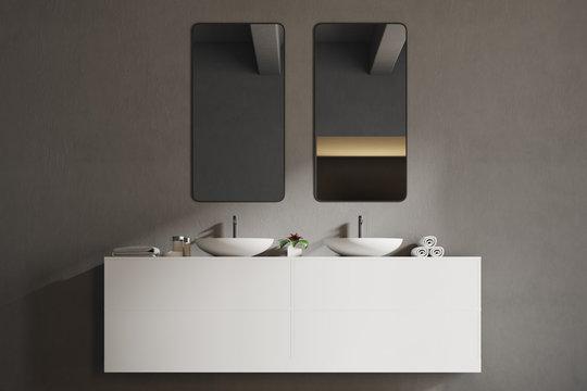 White sink vanity unit in a gray bathroom