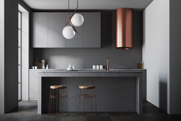 Black and bronze kitchen with a bar
