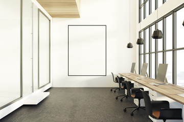 Open space office, black chairs, poster