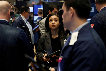 Traders work on the floor of the New York Stock Exchange shortly after the opening bell in New York