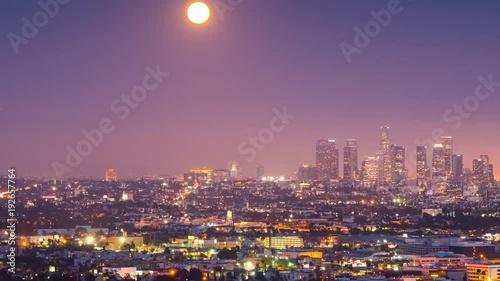 Fotobehang Moonrise full moon rising city Los Angeles cityscape downtown skyline, timelapse