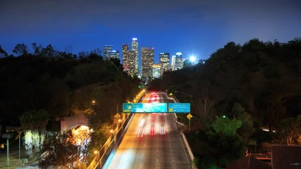 Fototapete - Freeway road to downtown city Los Angeles at night. 4K UHD Timelapse.