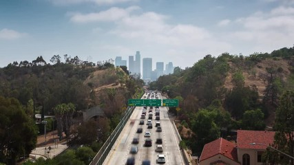 Fototapete - Freeway road to downtown Los Angeles at daytime. Zoom in. 4K UHD Timelapse.
