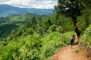 NEAR PHONGSALY, LAOS - AUGUST, 2017 : Hiker walking in a mountains  located in North of Laos.