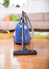 Vacuum cleaner on floor of living room