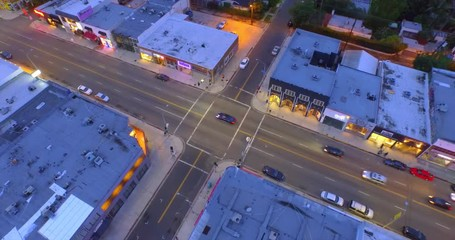 Fotobehang - Aerial view intersection of Melrose Avenue and Curson Ave at dusk. Los Angeles.