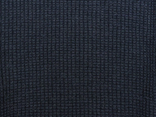Dark blue texture. Knitted fabric