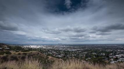 Fotobehang - Rainy storm clouds gloomy city Los Angeles skyline. Wide angle. 4K UHD Timelapse