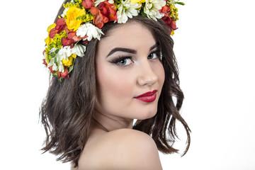 Beautiful woman in wreath of flowers