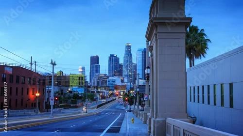 Fotobehang Hyperlapse walk towards downtown Los Angeles skyline sunset night city 4K UHD