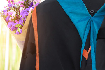 The back of the university graduates Bouquet of flowers congratulations to graduate