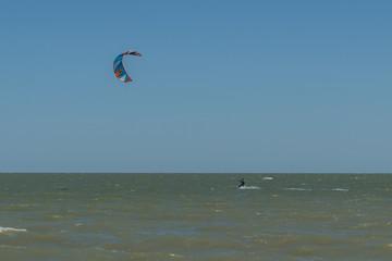 Man Kite Surfing Near Beach
