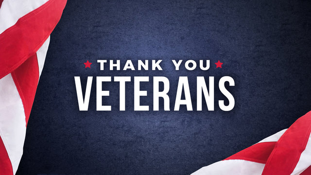 Thank You Veterans Text with American Flags Over Dark Blue Paper Background Texture