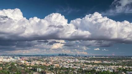 Fotobehang - Storm clouds city of Los Angeles skyline. Zoom in on downtown. 4K UHD timelapse.