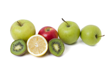 Fruits in a composition on a white background. Lemon with apples and kiwi on white background. Fruits with carrots on a white background.