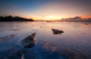 Sunrise seascape at Kudat, Sabah Malaysia. Image contain soft focus and blur due to long expose.