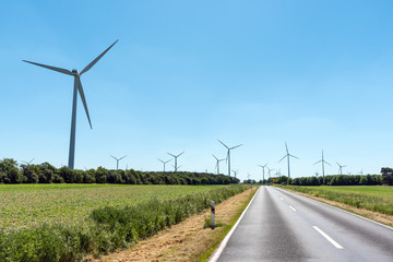 Wind power plants and a country road seen in Germany