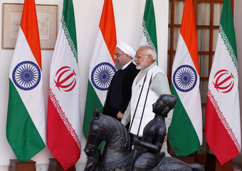 Iranian President Hassan Rouhani and India's Prime Minister Narendra Modi arrive for a photo opportunity ahead of their meeting at Hyderabad House in New Delhi