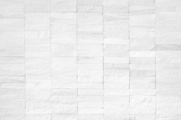 Rock stone limestone tile wall texture background in white color