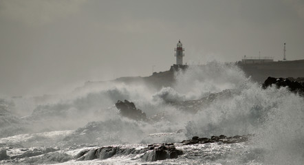 Coast with strong waves and lighthouse, Taliarte, Gran canaria, Canary islands