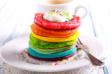 Rainbow pancakes, served in pile