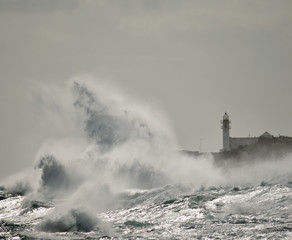 Big waves and lighthouse, coast of Taliarte, Gran canaria, Canary islands