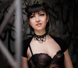 Fashionable stylish beautiful goth girl in old abandon place