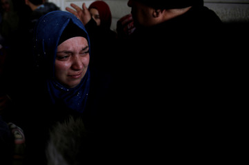 Relative cries during the funeral of Palestinian assailant Hamza Zamarah, in Halhoul, in the occupied West Bank