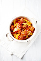 Pappardelle pasta with tomato sauce and meatballs