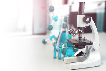 Microscope with lab glassware, flasks and colbas.Science laboratory research and chemistry white background.
