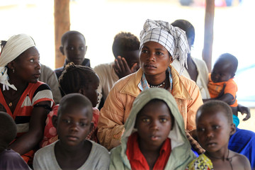 Congolese family, who migrated from Democratic Republic of Congo by fleeing on a boat across Lake Albert, waits to be registered by UNHCR in Ntoroko