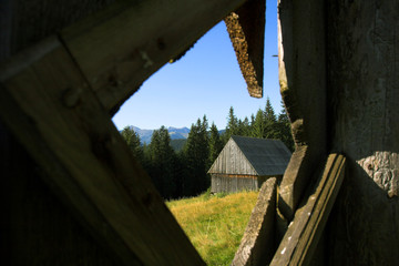The view throufh the small wood window of the Hayloft situated under Tatra mountains
